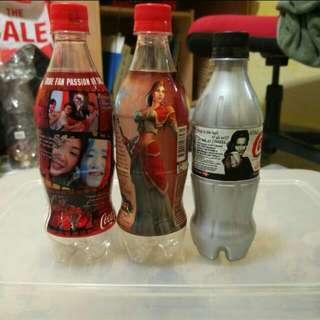 Emptied Singapore Coca Cola Plastic Bottles