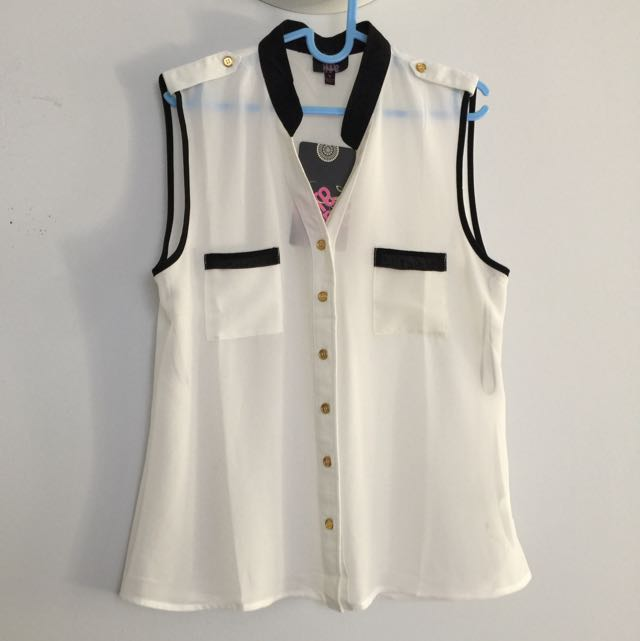 White sheer sleeveless blouse with black trimmings