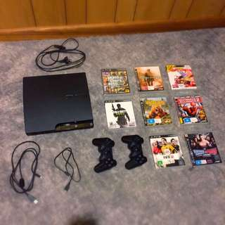 PS3 120GB Slim + 5 Games + 2 Controllers