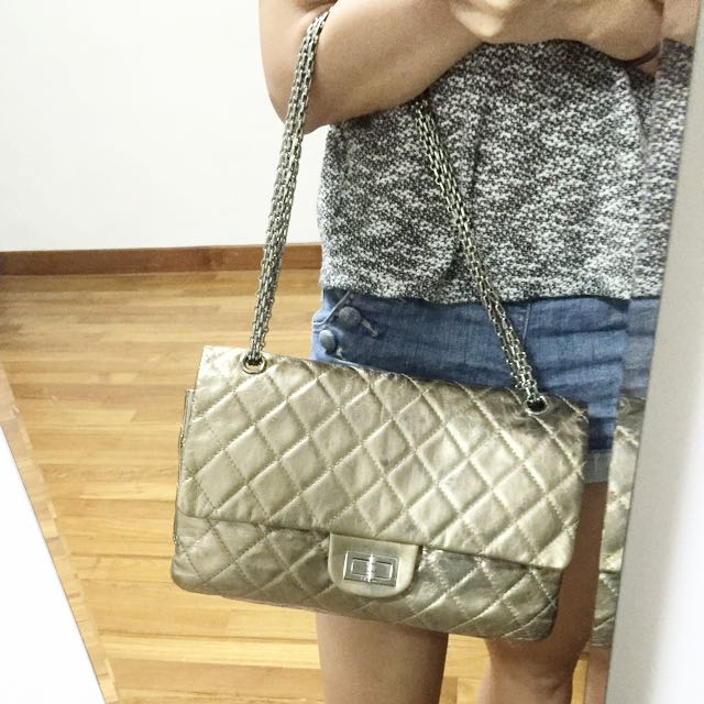 4028481f6b01a9 Chanel 228 reissue Gold on Carousell