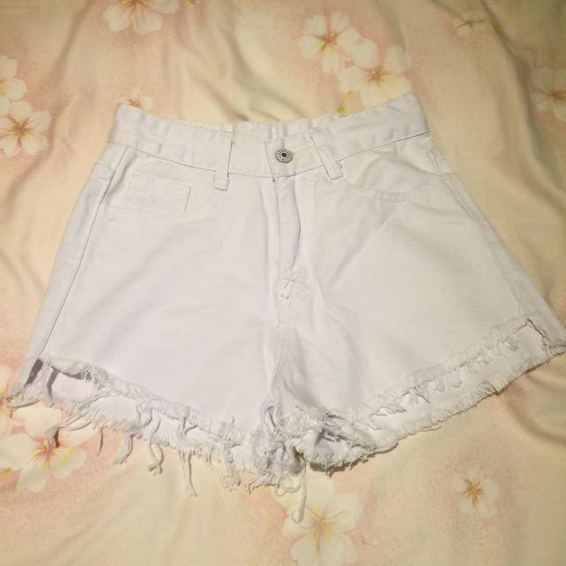白色前短後長牛仔褲