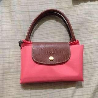 Longchamp橘粉色手提包
