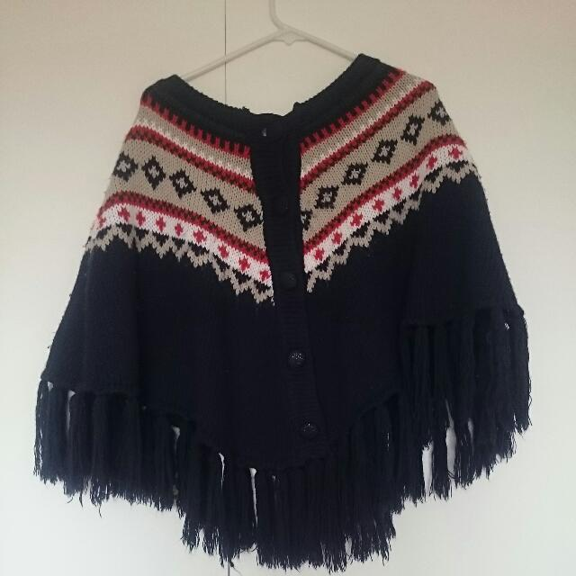 Knitted Cape With Tassle