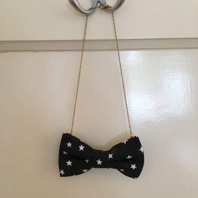 Black star bow tie necklace