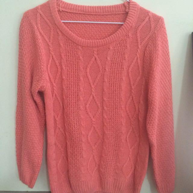 橘色麻花造型毛衣
