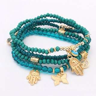 Simple Beads with Hamsa Detail
