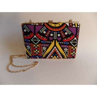 Bright, colourful Aztec pattern clutch