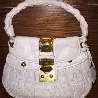 Miu Miu Mini Coffer Sling Bag
