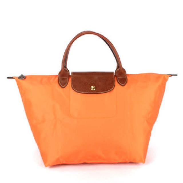 Longchamp全新橘色手提包