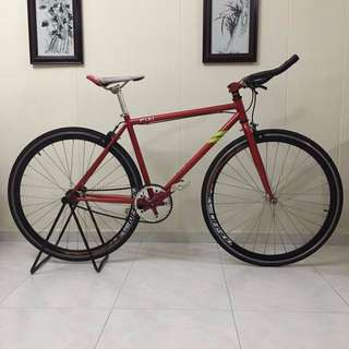 Red bullhorn handlebar Fixie with front and rear brakes.