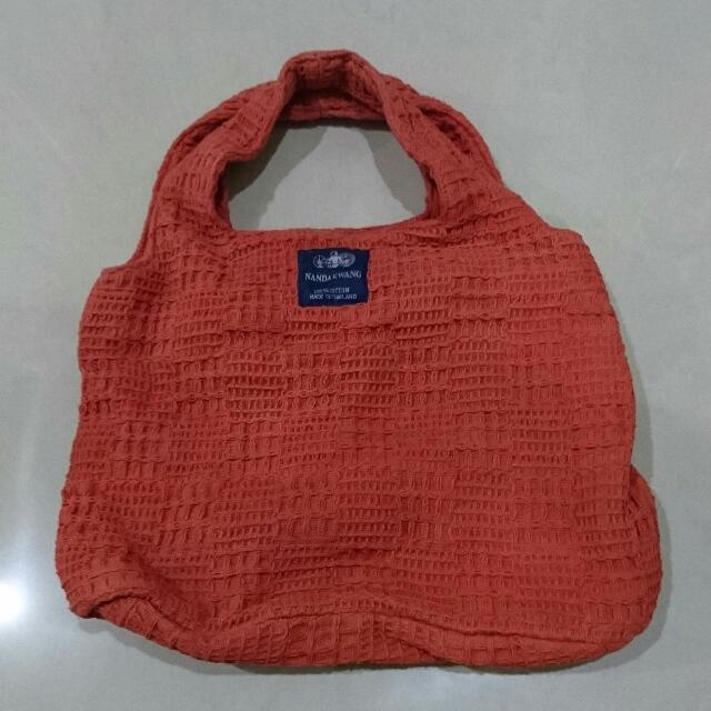 泰國 橘色編織手提小包