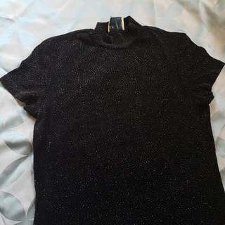 S Sparkly Top With A High Neck