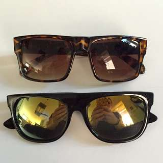 TWO PAIRS OF SUNGLASSES - BLACK ONES FROM GOVERNOR'S BALL MUSIC FESTIVAL; THE OTHER FROM A HIP EAST END BOUTIQUE!