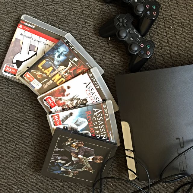 PS3 + 2 Controllers, Controller Charger, 5 Games