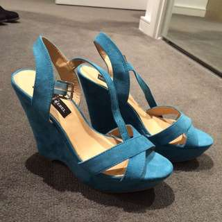 Aqua buckle up wedges