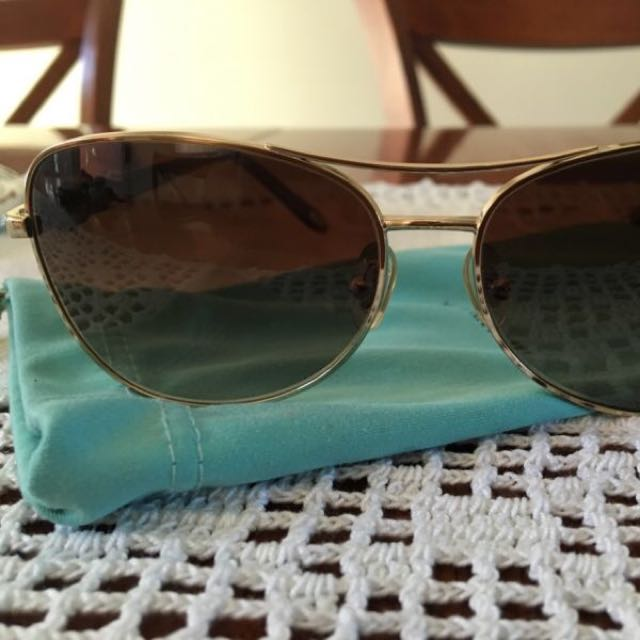 Tiffany &Co Sunglasses And Ted Baker Wallet.