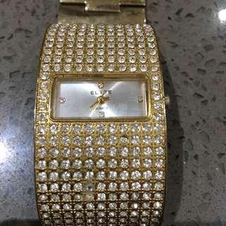 Elite Woman's Gold Watch