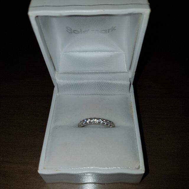 White gold round brilliant claw set band 10 ct. ***COMES WITH RECEIPT **** Make Offer