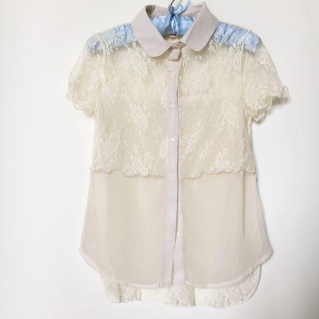 白色蕾絲上衣