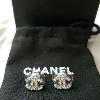 Authentic CHANEL Silver Mini Crystal CC Earrings.