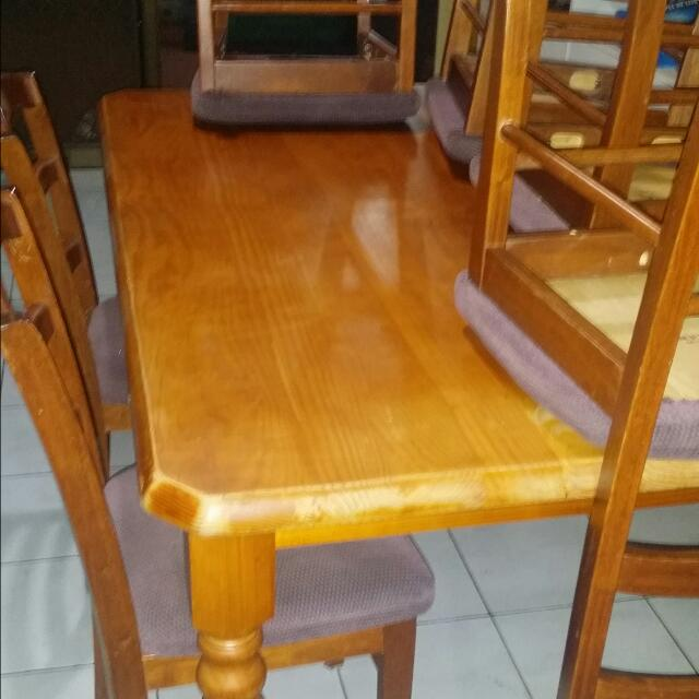 Dining table And 6 Chair's good Condition Has A Draw On The Side For Table Setting.selling To Downsize.