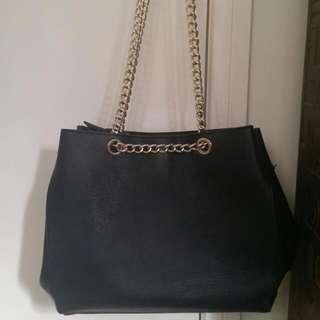Black Handbag With Gold Straps