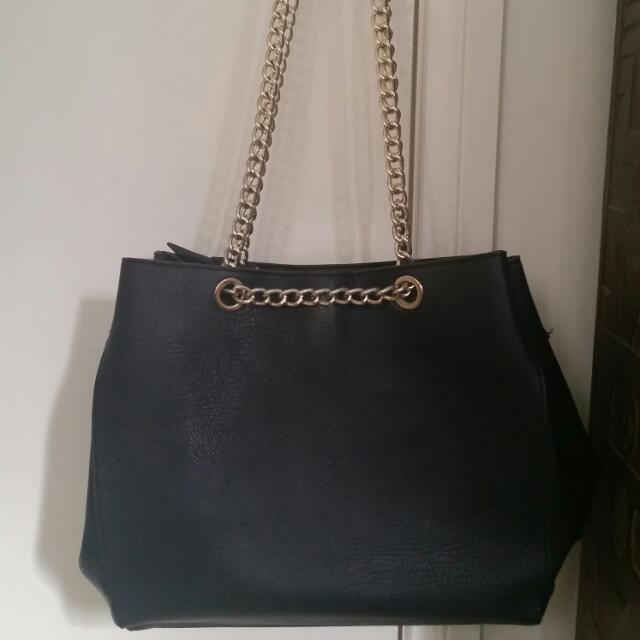 Black Handbag With Gold Straps