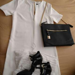 White Medium Dress, Black Purse With Gold Accents/Chain, Black Size 10 Heels.
