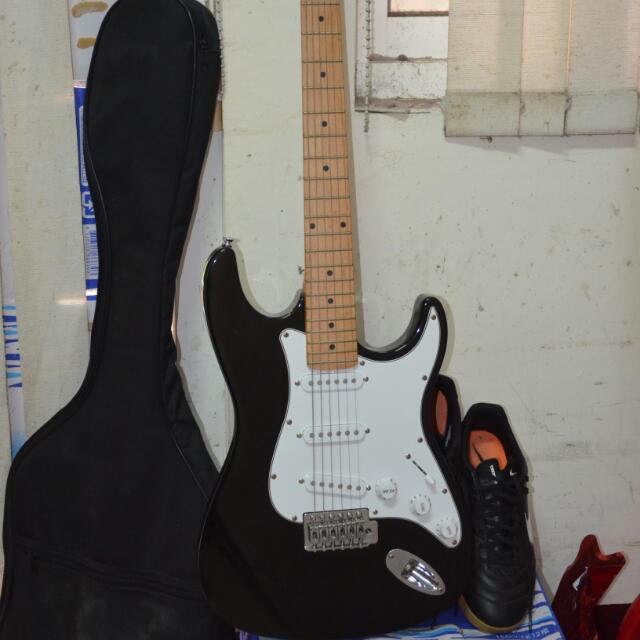 electric guitar with amplifier and guitar bag