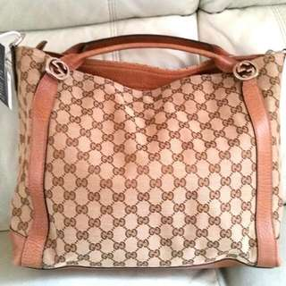 Gucci canvas with leather trim handbag