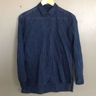Blue shirt with silver threads