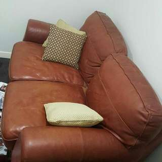 Pre Loved Great Condition brown Leather Two Seater.   Pick Up Only. Delivery will Be At An Additional cost