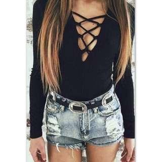 black long sleeve low cut top