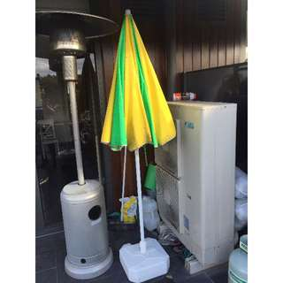 Parasol with base (green and yellow color) for beach as well