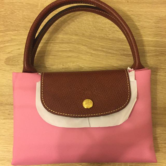Longchamp. M 粉紅短把