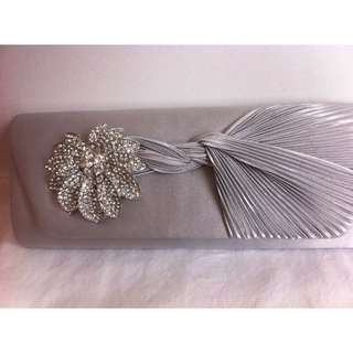 REDUCED - WAS $20 NOW $10 - SILVER SATIN CLUTCH WITH JEWELLED FLOWER DETAIL - NEVER USED - 2 AVAILABLE