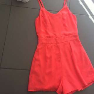 Size 6,Ally Play suit.In The Colour Coral