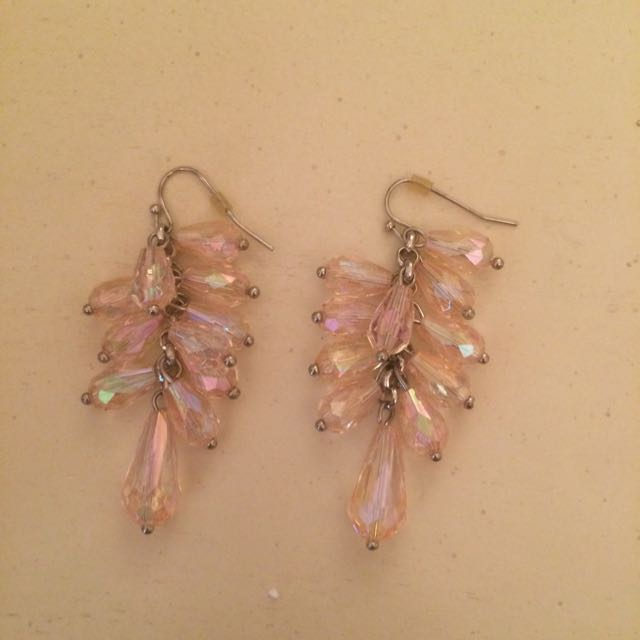 Crystal Dangling Earnings