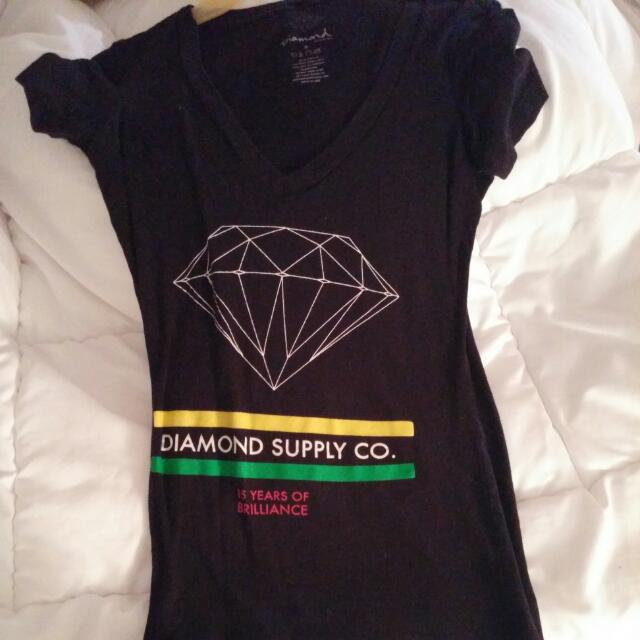 Small Diamond Supply V-neck T-shirt.