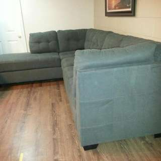 Ashley sectional couch Very Comfortable still Have Warranty on Frame