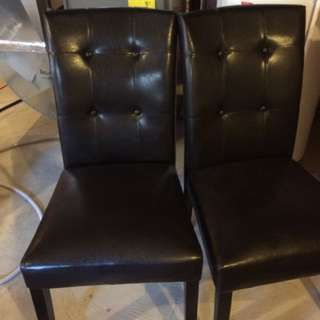 Two Dark Leather Chairs
