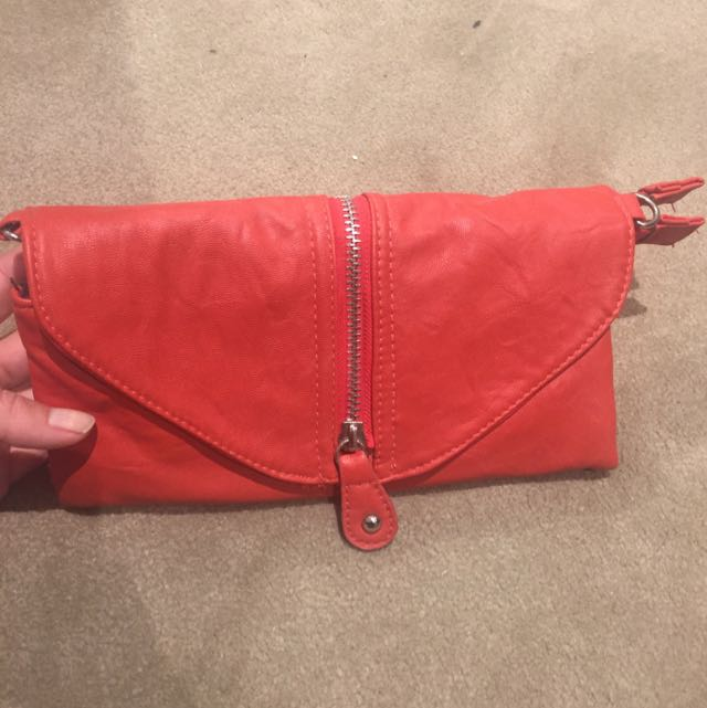 Gabby Wears Red Clutch