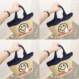 微笑流蘇手提包包