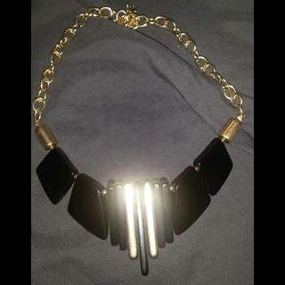 BOLD BLACK AND GOLD STATEMENT PIECE NECKLACE