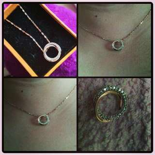 two-tone gold circle pendant pawnable