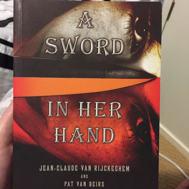 A Sword In Her Hand By Jean-Claude Van Rijckeghem And Pat Van Beirs