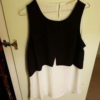 Elegant Black And White Sleeveless Shirt
