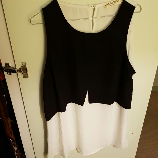 Elegant Black And White Sleeveless Shirt