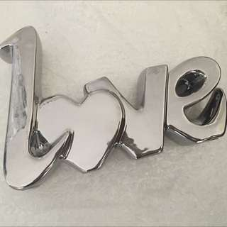 """love"" silver solid sign"