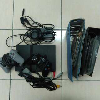 PS2 Slim, 2 Controllers, 30 Games, and Bag
